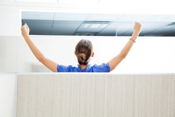Customer Service Representative With Arms Raised In Cubicle