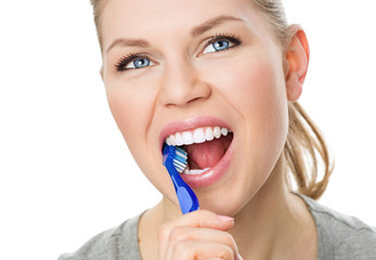 Oral hygiene. Young female cleaning her teeth and tongue