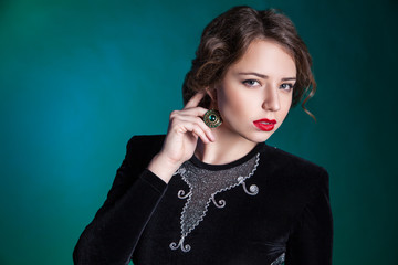 Portrait of beautiful young woman with evening make-up
