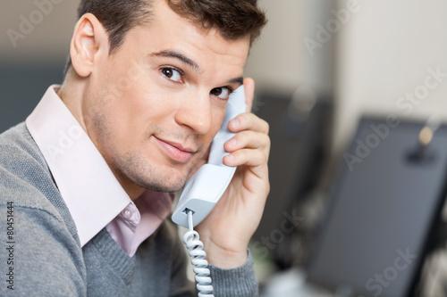 Leinwanddruck Bild Male Customer Service Representative On Call