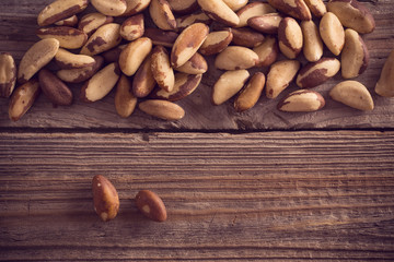 nuts on old wooden background