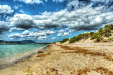 dramatic sky over Maria Pia beach in hdr