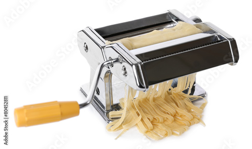 Metal pasta maker machine with dough isolated on white - 80452811