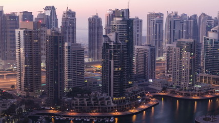 Dubai marina harbor from night to day transition timelapse close