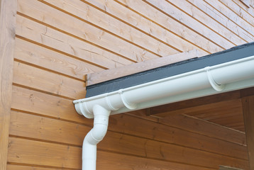 Closeup of problem areas for white rain gutter waterproofing.