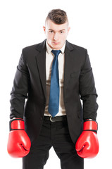 Competitive corporate boss wearing boxing gloves