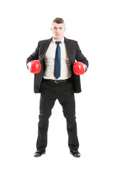Business man standing with red boxing gloves
