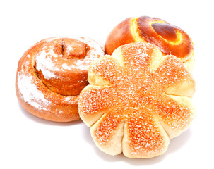 Fresh sweet buns and rolls with cream and cinnamon isolated