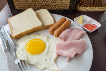English breakfast with fried eggs, bacon, sausages,