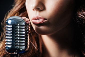 Girl with a retro microphone