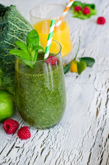 Fresh green smoothie and orange juice for healthy snack white ba