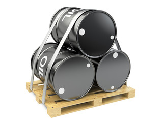 Black oil barrels on wooden pallet