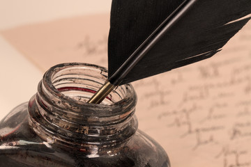 Quill and Inkwell in Sepia look Photograph