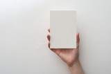 hand holding blank card on white background - 80459062