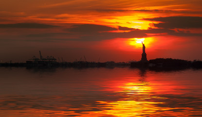 Statue of Liberty silhouette and the setting sun