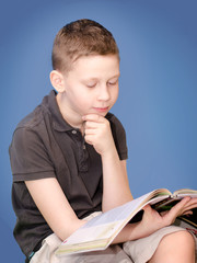 boy reading a book,making lessons