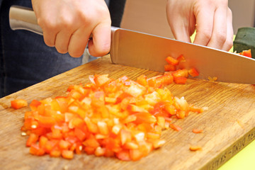 cutting fresh, raw paprika on the cutting board