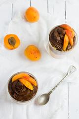 chocolate cream with granola and fresh apricot