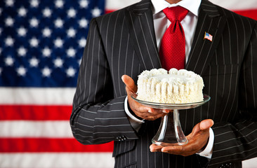 Politician: Holding a Cake on Cake Stand