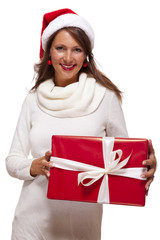 Pretty woman in a Santa hat with a large gift