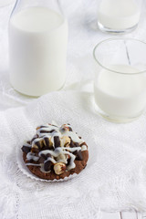 chocolate cookies with coffee cream, nuts and icing