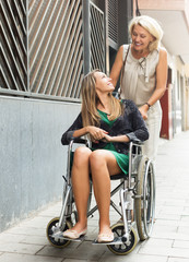 Happy woman in wheelchair  outdoor