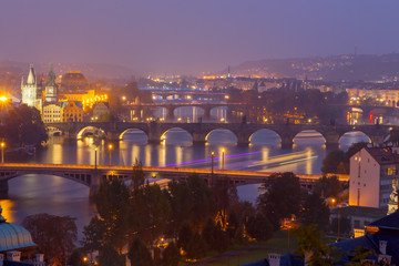 View of Prague and the Vltava River at night.