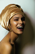 beauty african woman in shawl on head, very elegant look with go