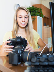 Female photographer in front of laptop