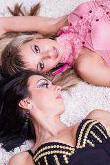 Two sexy beautiful women lying