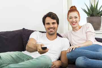 Happy Young Sweet Couple Sitting at the Couch
