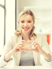young woman showing heart sign