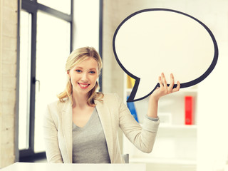 smiling businesswoman with blank text bubble