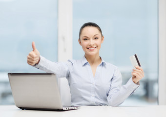 businesswoman with laptop in office