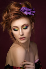 Portrait of beautiful redhaired woman with colourful creative ma