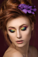 Portrait of beautiful red haired woman with colourful creative m