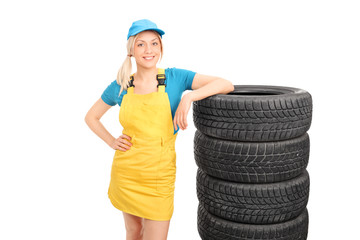 Beautiful female mechanic in a yellow uniform