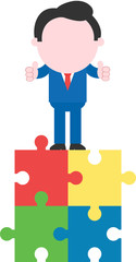 Businessman standing on puzzle pieces