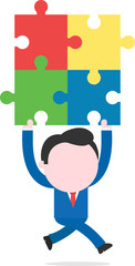 Businessman running and lifting puzzle pieces