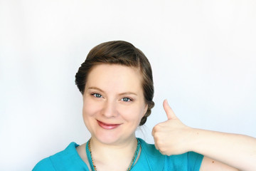 Portrait of young attractive women with thumb up