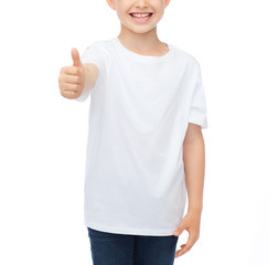 boy in blank white t-shirt showing thumbs up