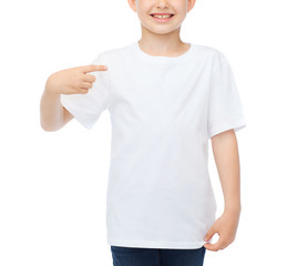 smiling little boy in blank white t-shirt