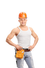Handsome construction worker with a tool belt