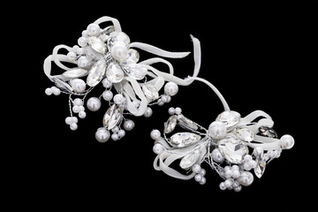 Pearl brooch on isolated black background
