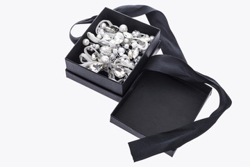 Pearl brooch in black gift box on white background