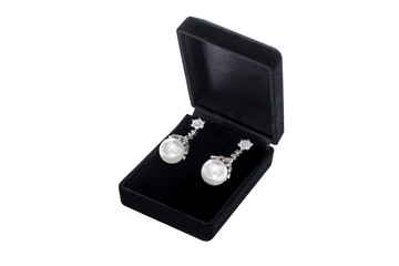 Silver earrings in black gift box on white background