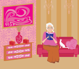 Senior woman in living room reading a book