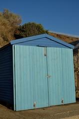 Wooden blue beach hut shed
