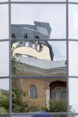 Mirrored old and new building