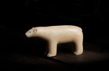 antique polar bear figure made from warlus tusk poster
